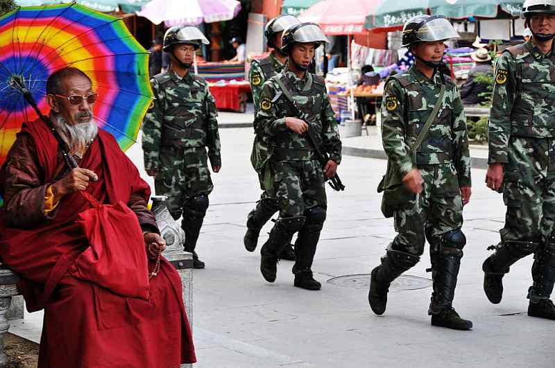 31-chinese-with-a-colorful-umbrella-while-soldiers-are-passing