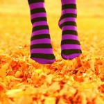 jumping-girl-stockings-yellow-leaves-fall