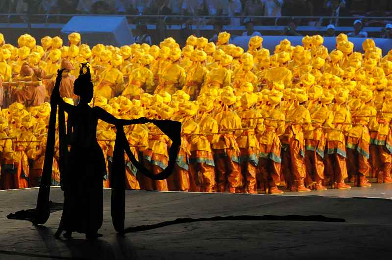 25-dancers-in-yellow-costume-with-lady-in-silhoutte