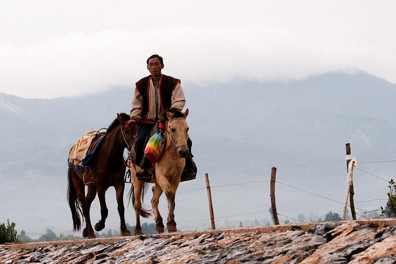 28-man-riding-on-a-horse-and-holding-another-horse